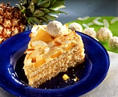 A piece of pina colada cake with pineapple and coconut balls