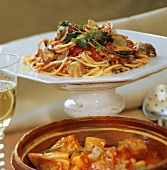 Spaghetti with clams and stockfish and potato soup