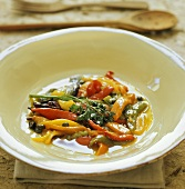 Grilled peppers with parsley in white dish