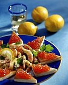 Shrimps with lemon and caviare toast on plate