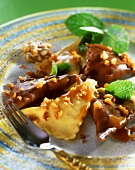 Sweet ravioli with nuts and mint leaves