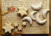 Cinnamon stars & vanilla crescents on hand-written recipes