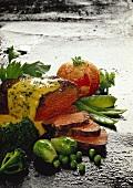 Roast beef with vegetables on asphalt background