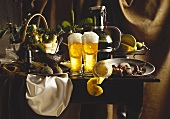 Still life of light beer with lemon, fruit and nuts