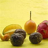 Various exotic fruits on pale green background