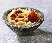 Rice pudding with caramel in a grey bowl