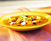 Pumpkin soup with pumpkin seeds and blobs of cream