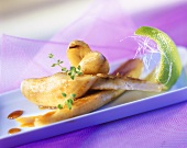 Fried caramelised bananas with a wedge of lime