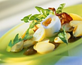Dandelion salad with potatoes, bacon and egg