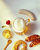 Snack of Weisswurst, pretzel, mustard, radishes and beer