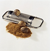 Nutmegs, ground nutmeg and grater