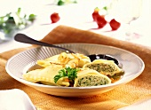 Pasta envelopes (Maultaschen) with parsley in soup plate
