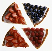 Four pieces of tart strawberry, raspberry and blueberry