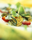 Marinated courgettes with basil on toothpick