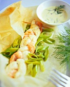 Fish plait on spring onions with dill sauce