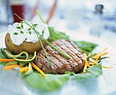 Beef steak and baked potato with herb quark