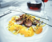 Duck breast with orange sauce, apricots and almonds