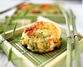 Fish and shrimp cakes on bamboo mat