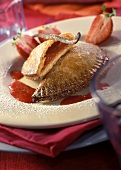 Rhubarb pie with strawberry sauce and icing sugar
