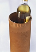 Terracotta wine cooler with white wine bottle
