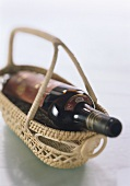 Wine basket with a red wine bottle