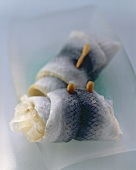 Two rollmops in a white dish