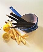 Scorzonera in and beside strainer, lemons