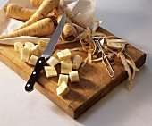Parsnips, partly peeled and cut up