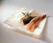Fresh halibut fillets on paper