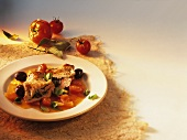Veal escalope with olive stuffing in tomato sauce