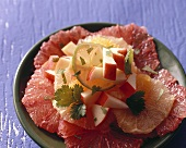 Spicy citrus fruit salad with apple and fresh coriander