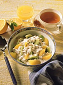 Kiwi fruit and orange muesli, tea and orange juice