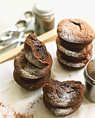 Chocolate buns with icing sugar in two piles