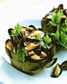 Mussels in half an artichoke