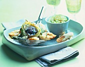 Vegetable tempura with lime dip in turquoise bowl