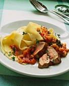 Pork fillet with pappardelle and diced tomatoes