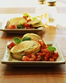 Baked courgette slices with mozzarella and diced tomatoes