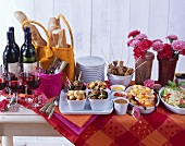 Tapas buffet with red wine & baguette; decoration: flowers