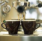 Espresso Pouring into Cups