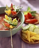 Tomato fondue with noodles, courgettes and chard