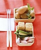 Potato fondue with sesame feta, courgettes and shallots