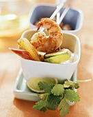 Creole fondue with fruit and shrimps in bowls