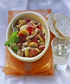 Meat stew with chorizo and mushrooms; white bread