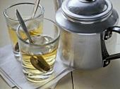 Greek mountain tea in glasses and metal teapot
