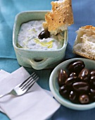 Cucumber & yoghurt mousse (Tzaziki) with olives & flat bread
