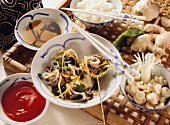 Chinese fondue with meat, vegetables, glass noodles & rice