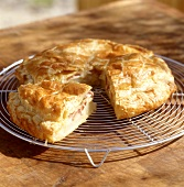 Savoury potato and cheese pie on cake rack
