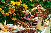 Harvest Festival buffet with cake, sausage, bread & fruit