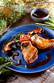 Duck confit with asparagus and red wine sauce