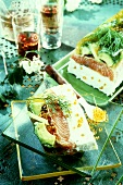 Salmon and avocado terrine with caviare (a slice cut)